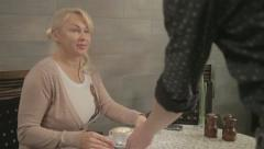 Woman brought a cup of coffee at the bar Stock Footage