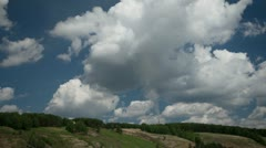 Clouds over green hills and pipe smoke timelapse Stock Footage
