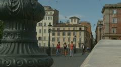 Pedestrians walk over Tiber bridge in Rome (3) zoom Stock Footage
