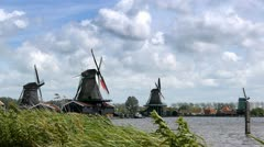 Panorama of Dutch wind mills at the Zaanse Schans in Holland - stock footage