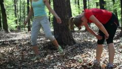 Two young women jogging and exercising in the forest, stedycam, slow motion Stock Footage