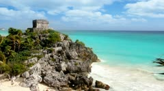 Ancient Tulum Mayan ruins over turquoise Caribbean sea Stock Footage