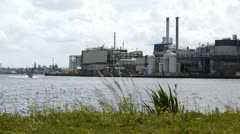 Industrial landscape with grass in a breeze Stock Footage