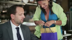 Young couple meet in lunchtime after shopping on lunch Stock Footage