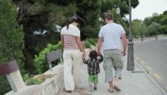 Happy family walking in the park Stock Footage