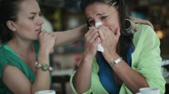 Female friend comforting sad woman in the restaurant, steadycam Stock Footage