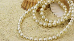 Pearls necklace on sand Stock Footage