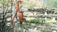 Old dry water pump far pumping Stock Footage