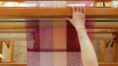 Weaving tea towels on a loom Stock Footage