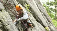 Girl rock climbing Stock Footage