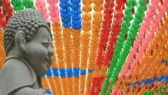 Buddhist stone statue smiling and Paper lotus lantern Stock Footage