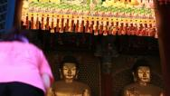 Asian woman bowing down to pray Buddha in temple Stock Footage