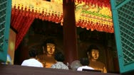 Asian women praying Buddha in temple Stock Footage