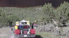 Fire trucks moving towards a fast moving wild fire HD6632 Stock Footage