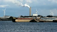 Windmills, coal plant and ships in Amsterdam Harbor Stock Footage