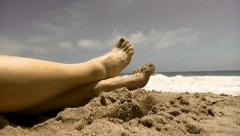 Female relaxing hot summer day sexy naked legs sand attractive barefoot Stock Footage