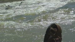 Rushing River & Leather Sandal Stock Footage