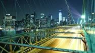 Stock Video Footage of city traffic on Brooklyn bridge at night. Time lapse and loopable