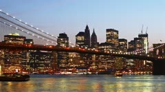 Beautiful view of Manhattan skyline and Brooklyn bridge at sunset, time lapse Stock Footage