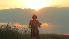 The nice young woman in the cereal field (sunset time) Stock Footage