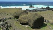 Easter Island Akahanga fallen moai by sea Stock Footage