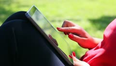 Woman using a tablet computer - stock footage