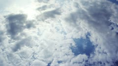 HD Zoom In Deep Blue Sky .. White and dark Clounds, and Bright Sun before Storm Stock Footage