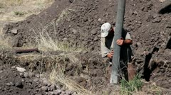 Workers pouring cement in footings - stock footage