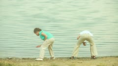 Skipping stones together Stock Footage