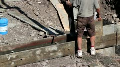 Workers Pour Footings for House - stock footage