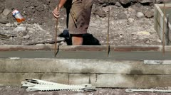 Putting Metal Rebar into Footings - stock footage