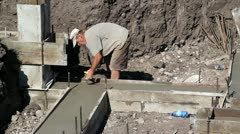 Chalking a Line on Footings - stock footage