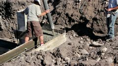 Cement pumped into footings of house - stock footage
