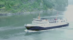 Passengers ship with tourists on deck float in fiord - stock footage