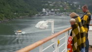 Parents with their son stand wrapped in blanket at board of ship Stock Footage