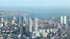 Aerial view of the Bosphorus strait and Marmara sea  through the city in Stock Footage