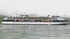Huge passengers liner near coastline with mountain Stock Footage