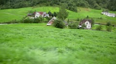 Small village near river among trees under moutain Stock Footage