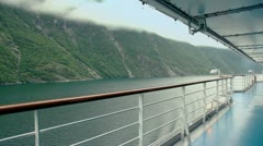 Empty deck of ship float on fiord near mountain with forest Stock Footage