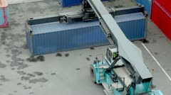 Crane lifts large weight container, view from above Stock Footage