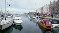 Many boats are in dock of coastal town Bergen at bay Vagen Stock Footage