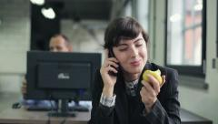 Young happy young businesswoman chatting on cellphone in the office HD Stock Footage