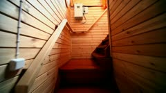 Instep by staircase in wooden house, shown in motion Stock Footage