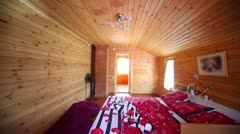 Bedroom in wooden house lit by light from windows Stock Footage