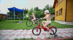 Boy and girl ride on bike, other boy run, father makes kebab - stock footage