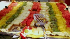 Lot of pieces of fruit cake, close up view in motion Stock Footage