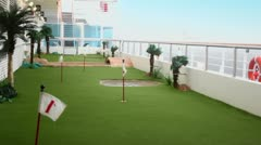 Field for mini golf on deck of ship which float on wavy sea Stock Footage