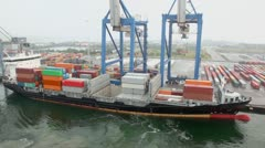 Large cranes and vessel with containers on board in seaport Stock Footage