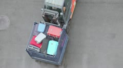 Loader moves tray with passengers luggage, view from above Stock Footage