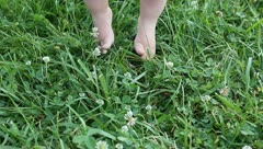 Baby feet playng in the grass Stock Footage